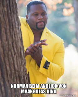 Anthony Adams in Yellow Suit Rubbing Hands